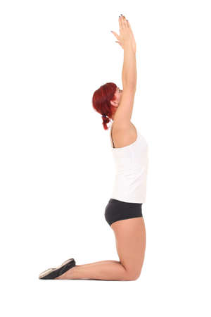 Young woman training yoga.sun salutation lap, hero pose photo