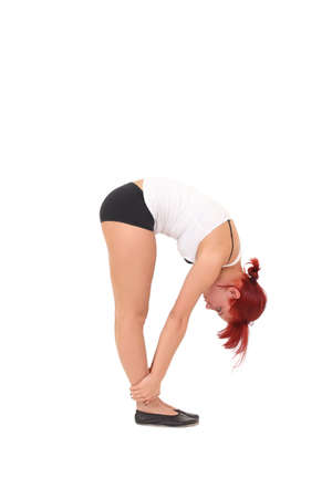 Young woman training yoga.tilt forward photo
