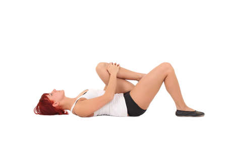 Young woman training yoga.knee to the chest photo