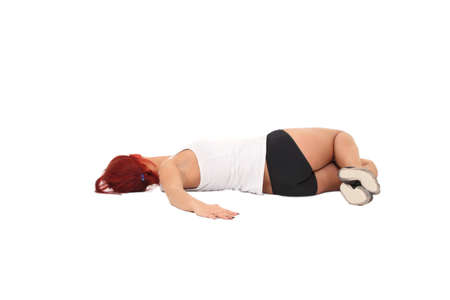 Young woman training yoga.twisting in the supine position photo