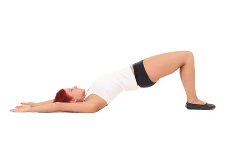 Young woman training yoga.bridge pose photo