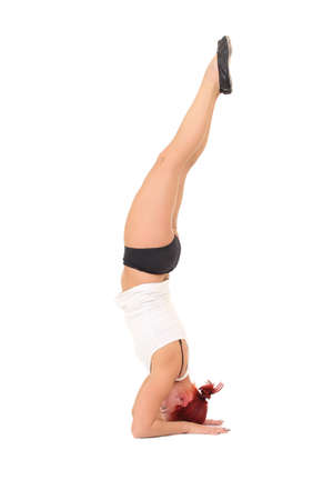 Young woman training yoga.headstand photo