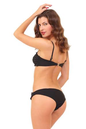 beautiful young woman in a bikini with a beautiful slender ass photo