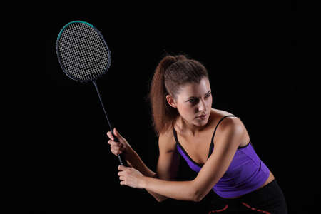 badminton racket: woman with badminton racket isolated on black Stock Photo