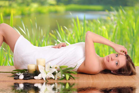 sexual chakra: Spa Woman.woman relaxing in spa, with reflection on the water