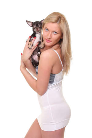girl with chihuahua in her arms photo