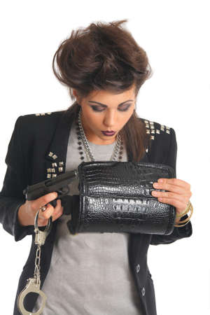 juvenile delinquent: portrait of a woman with a gun and handcuffs Stock Photo