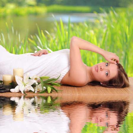 sexual chakra: beautiful woman getting treatment in spa salon