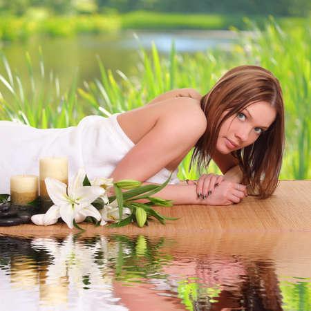 sexual chakra: beautiful blond woman relaxing in spa salon