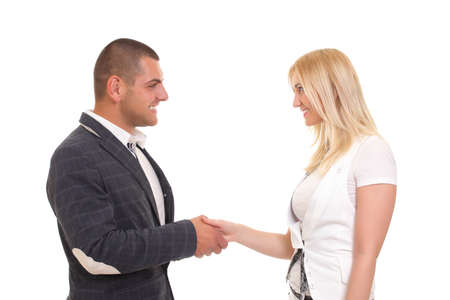 Handshake business woman and businessman photo
