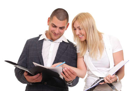 woman and a man looking at paper folder photo