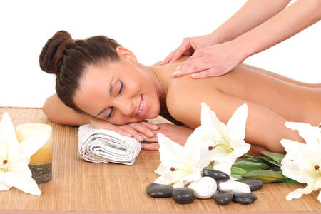 massaged: young woman relaxing beeing massaged in spa saloon