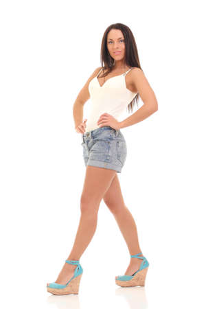 girl in a white T-shirt and denim shorts photo