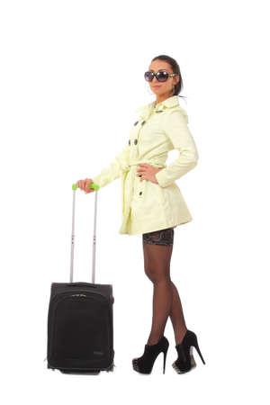 кавказцы: женщина собирается на праздник с чемоданом Фото со стока