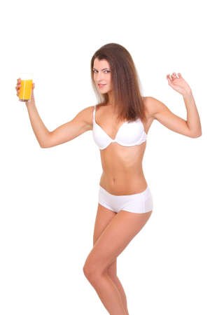 Girl with a beautiful figure holding a glass of juice photo