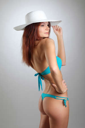 sexy young woman in a bathing suit and white hat photo
