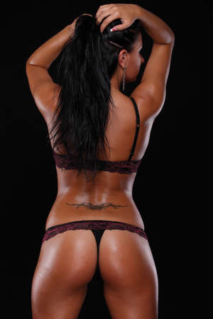 sexy woman in lingerie. on a black background