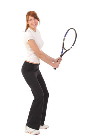 Slim brunette playing tennis photo