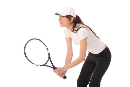 Slim brunette playing tennis photo