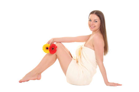 beautiful smiling spa woman in towel sitting photo