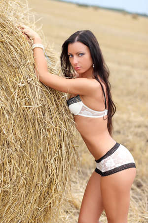 girl in underwear in a field with hay photo