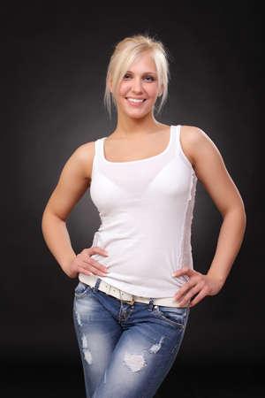 탱크 탑: young blonde wearing jeans and a tank top 스톡 사진