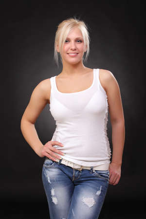 young blonde wearing jeans and a tank top photo
