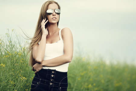 Beautiful woman in sunglasses photo
