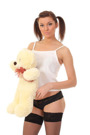 sexy girl in lingerie with a teddy bear photo