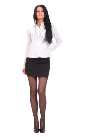 young woman in a white shirt and black skirt photo