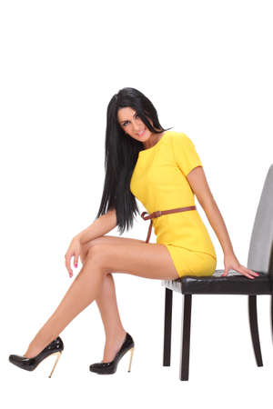 young sexy girl in a yellow dress photo