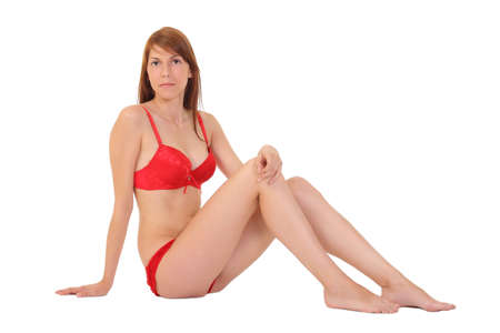 Young girl sitting in red lingerie photo
