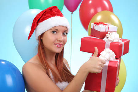 Surprised and happy girl with gifts photo