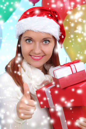 beautiful girl dressed as Santa with a gift box photo