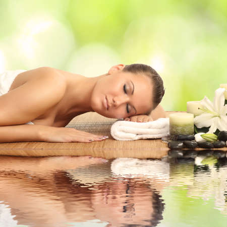 woman in spa salon lying on the massage desk photo