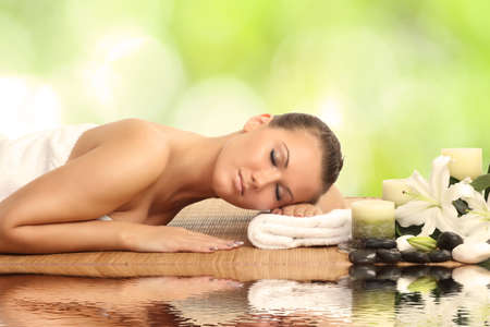 woman in spa salon lying on the massage desk Stock Photo - 25059640