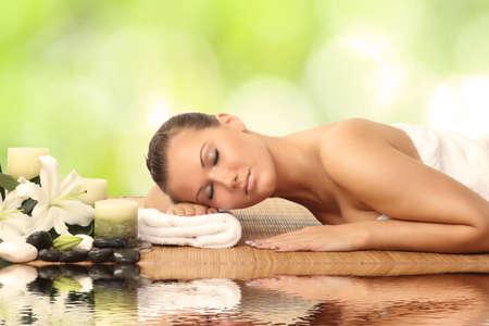 woman in spa salon lying on the massage desk Stock Photo - 25064878
