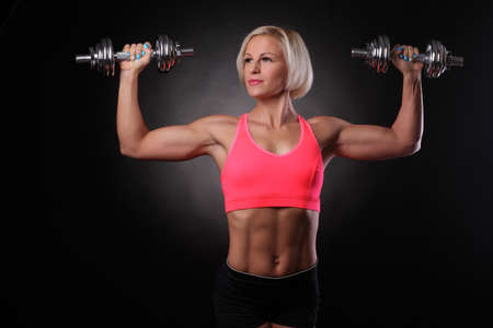 fitness model with dumbbells photo
