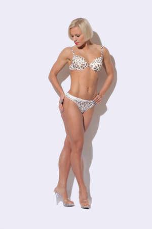 sexy bikini girl: Beautiful athletic woman in bikini Stock Photo