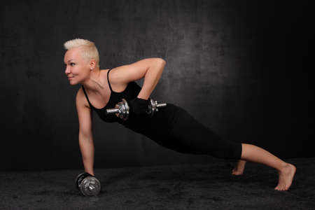 sporty woman with a dumbbell photo