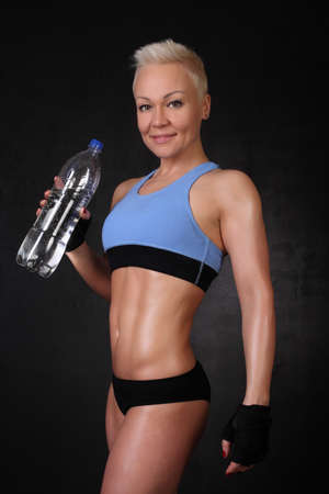 sportswoman with a bottle of water photo