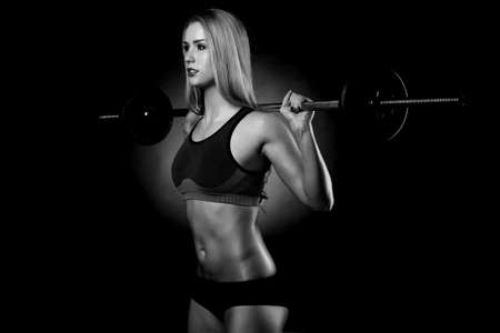 beautiful sports fitness girl with a barbell Stock Photo - 27990043