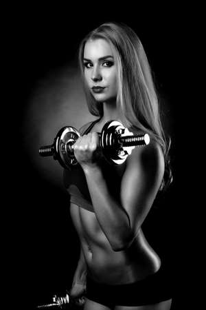 woman lifting dumbbells Stock Photo - 27990044
