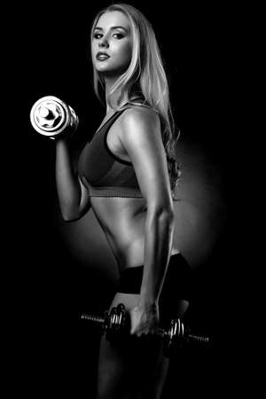woman lifting dumbbells photo