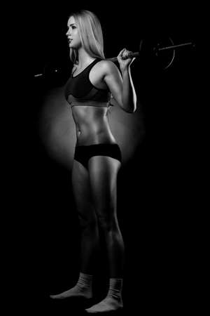 beautiful sports fitness girl with a barbell Stock Photo - 27942606