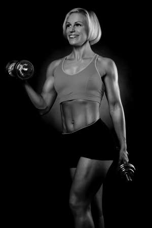woman lifting dumbbells photo