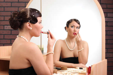 haircurlers: girl gets makeup near mirror