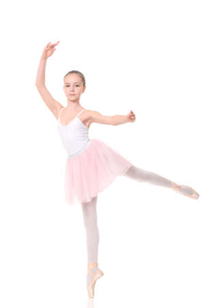 petti: school age girl playing dress up wearing a ballet tutu, isolated on white