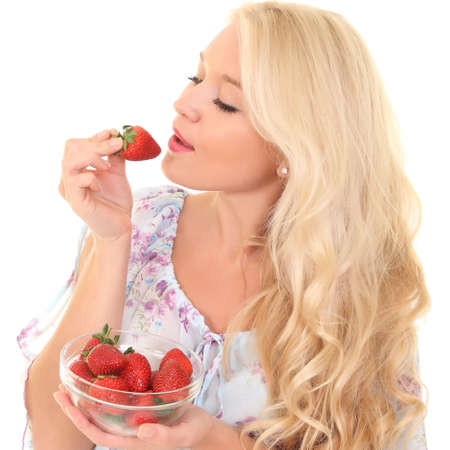 Portrait of young woman with strawberry