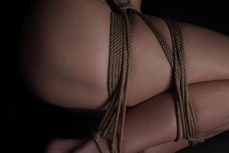 Young woman with shibari photo